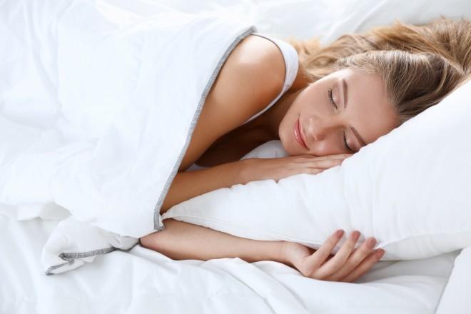Beautiful girl sleeps in the bedroom .