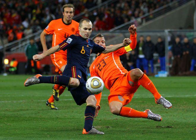 JOHANNESBURG, SOUTH AFRICA - JULY 11: Andres Iniesta of Spain scores the winning goal during the 2010 FIFA World Cup South Africa Final match between Netherlands and Spain at Soccer City Stadium on July 11, 2010 in Johannesburg, South Africa. (Photo by Lars Baron/Getty Images)